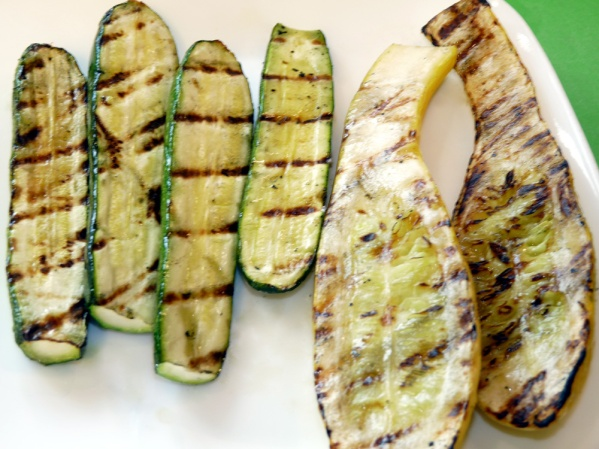 Cut ends off zucchini and summer squash and slice lengthwise. Brush with oil and char on grill. Let cool and slice. Add to bowl.