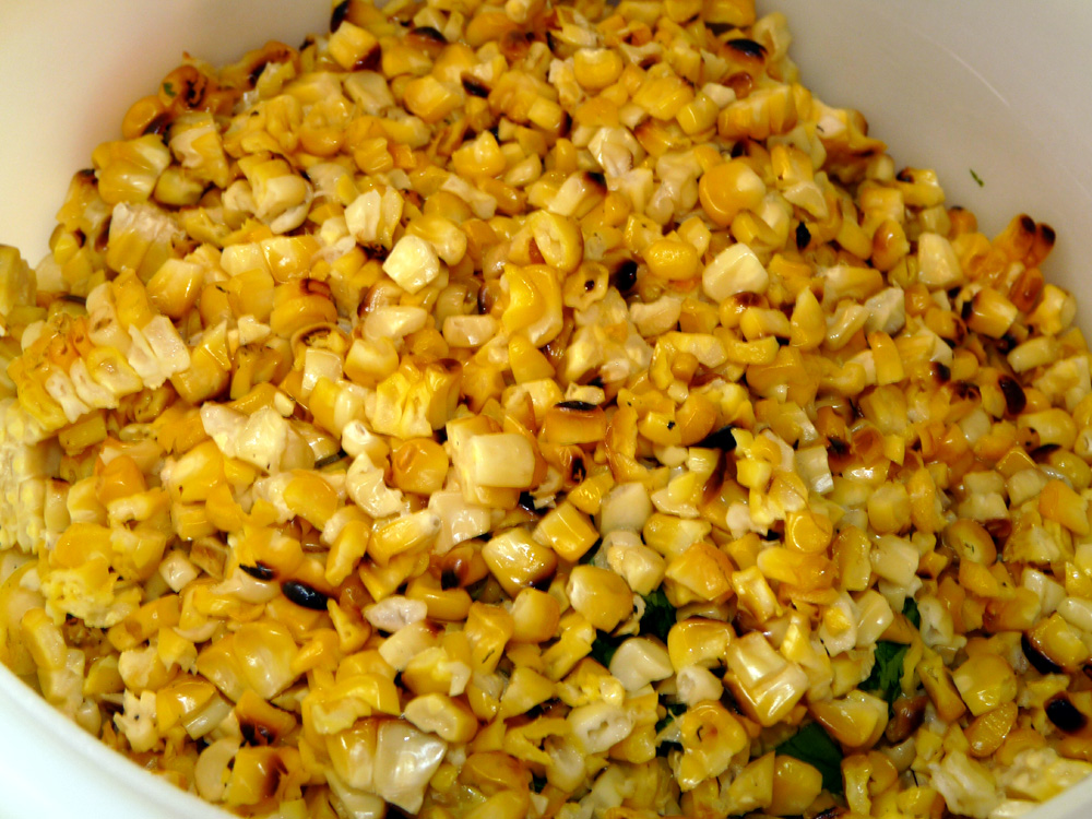 When cobs are cooled, slice kernels off and add to bowl.