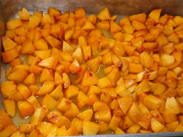 Layer peaches in the baking pan over the juice.