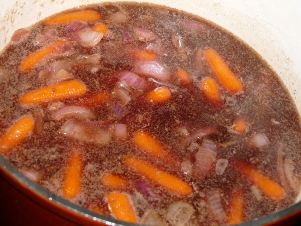 Add wine, broth and seasonings to the Dutch oven.