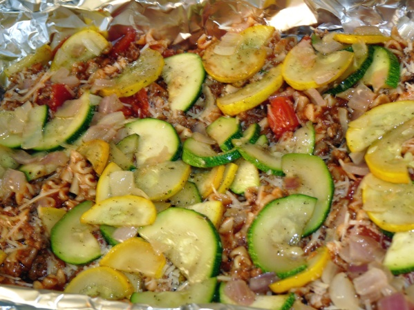 Spread half of the zucchini and onions for the next layer