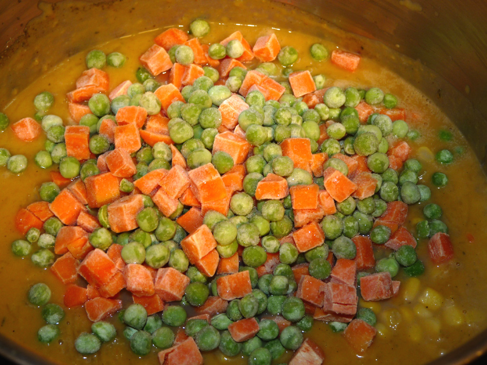 In a soup kettle, add pureed squash, chicken broth, can of corn with liquid, frozen peas and carrots. Stir in spaghetti squash. Bring to a bubble, stirring often, then reduce heat and simmer for about 20 minutes to heat through.