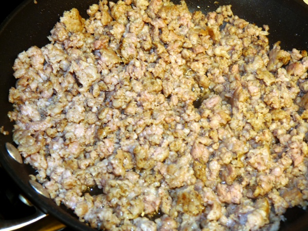 Fry sausage in a nonstick skillet until browned, breaking into smaller pieces as it cooks. Remove from skillet and set aside.