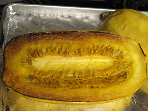 Cut spaghetti squash in half and roast face down at 400°F until a fork easily pierces the shell, about an hour. Cool and scoop out seeds. Scoop squash strands into a container and refrigerate if not used immediately.