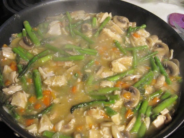 Add chicken broth, lemon juice, pepper and pinch of cayenne. Stir well