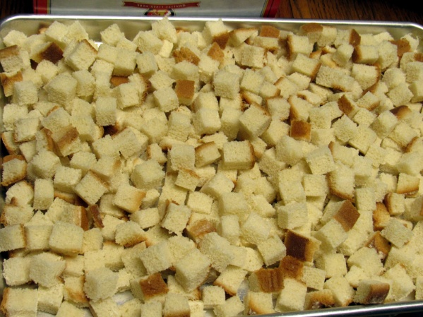 Cut bread into cubes and toast in oven until desired color.