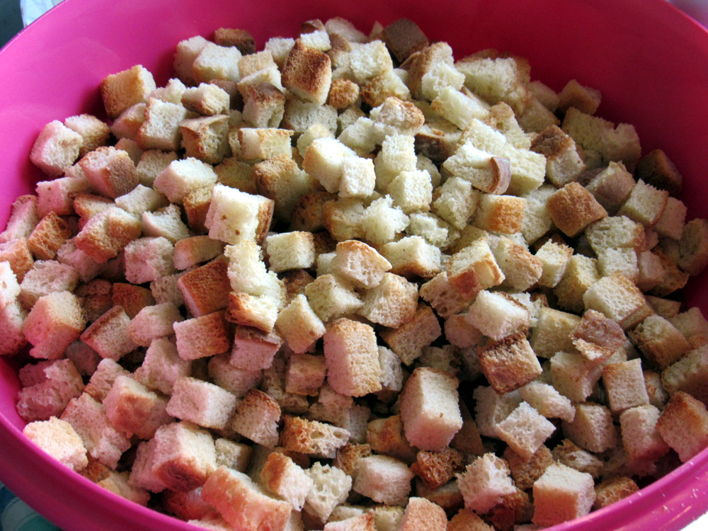 When ready to make stuffing, pour bread cubes into large bowl. Add seasonings and mix.