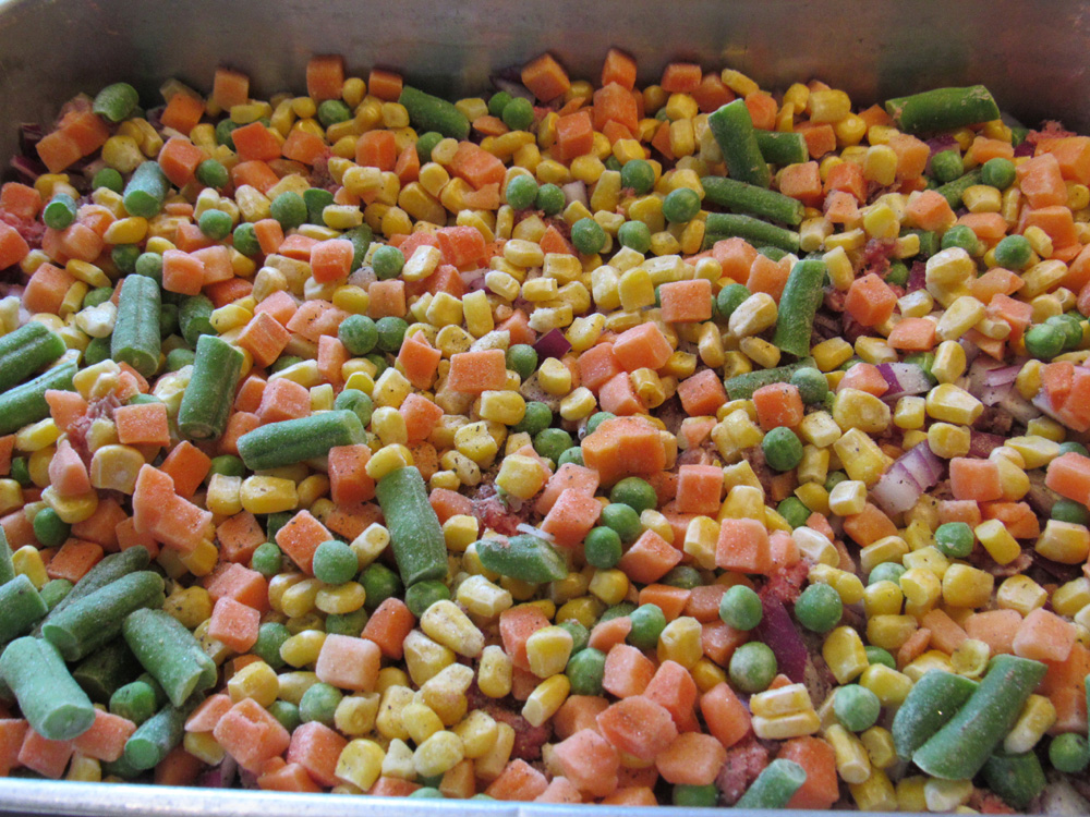 Pour frozen vegetables evenly into the pan.