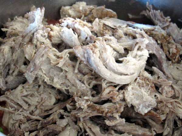 Chop shredded pork into bite-sized pieces and dump into soup pot.