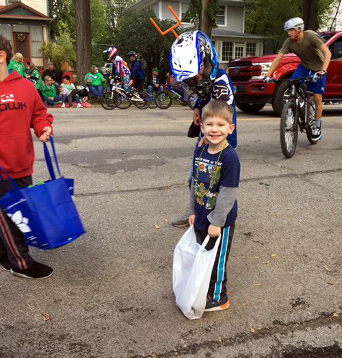 Grady learns to collect parade candy